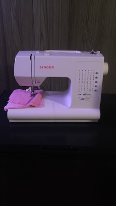 white Singer electric sewing machine