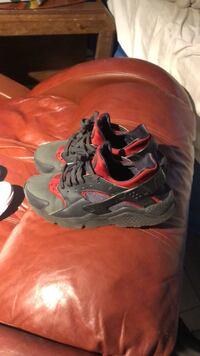 Pair of gray-and-red nike basketball shoes Orlando, 32805