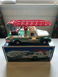 white and green gasoline ride-on toy