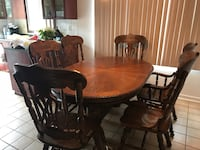 oval brown wooden dining table with chairs set Laval, H7M 2E8