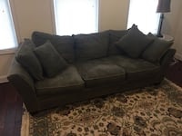 "Dark green ""Comfy"" couch very nice.  Street, 21154"