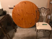 round brown wooden table with chairs Ashburn