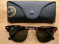 black Ray-Ban sunglasses with brown frames 785 km