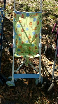 baby's green, teal, and red umbrella stroller Orlando, 32837