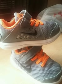 pair of gray Nike running shoes Garden City, 67846
