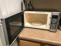 gray and black microwave oven 8 km