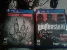 two PS4 Evolve and Wolfenstein game cases