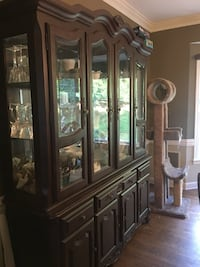 Large china cabinet w lots of milk glass that conveys Warrenton, 20186