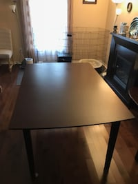rectangular brown wooden table with chairs New Tecumseth