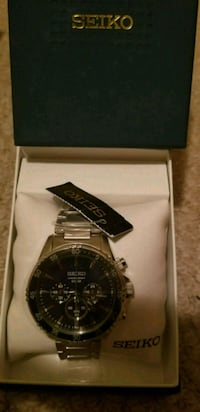 round silver chronograph watch with silver link bracelet in box North York, M2M