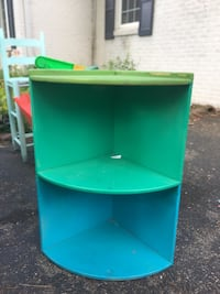 Green and blue corner shelf unit. Indianapolis, 46205