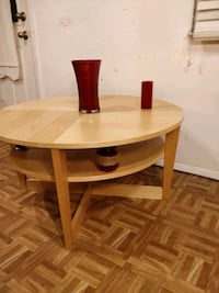 Like new wooden round table with shelf in great co 21 mi