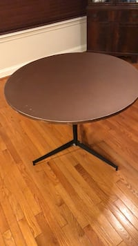 round brown wooden pedestal table Owings Mills, 21117
