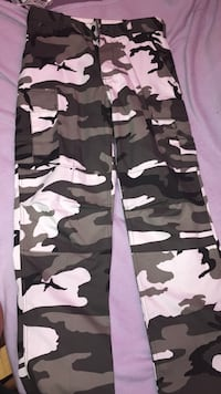 White, gray, & black camouflage cargo pants .. also never worn, they're too big.
