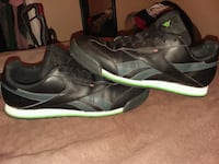 pair of black-and-green Nike basketball shoes Fort Walton Beach, 32548