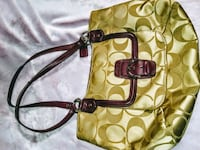 yellow and brown Coach monogram shoulder bag