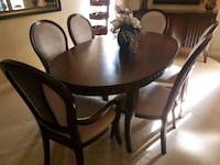 round brown wooden table with four chairs dining s West Kelowna, V4T 2M3