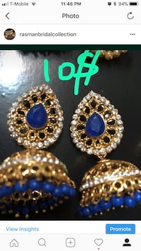Pair of gold-colored and blue jhumkas earrings screenshot