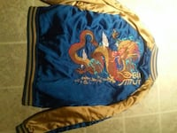 blue and yellow dragon print letterman jacket
