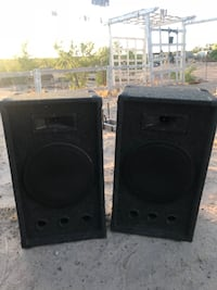 two black PA speakers with amplifier Fabens