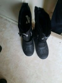 pair of black leather boots 3140 km