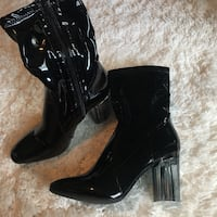 pair of black leather heeled boots Normal, 61761