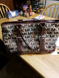 MK signature brown and tan cloth and leather tote