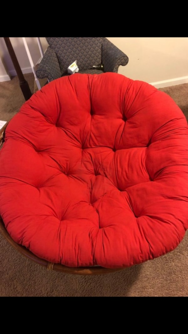 red tufted padded sofa chair