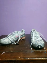 pair of gray-and-white Nike basketball shoes Delta, V4E 2W9