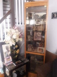 Brown wooden framed glass display cabinet . Negotiable West Babylon, 11704