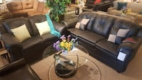 black leather padded sofa set with round metal based glass coffee table Toronto, M9W 1P6