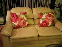beige leather 2-seat sofa with two floral pillows Springfield, 22150
