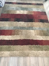 brown, red, and black area rug OAKVILLE