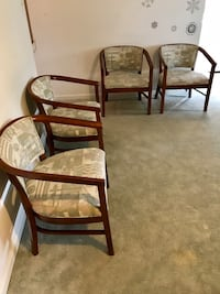 Two brown wooden framed padded armchairs 43 km