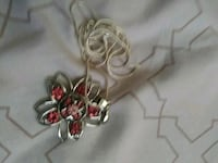 silver-colored red gemstone flower pendant necklace