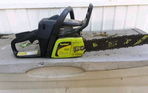 black and yellow Poulan chainsaw 4a28ed3c-0d5f-4b16-87e1-493541445422