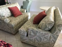 gray fabric sofa chair with throw pillows