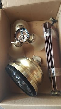 brown five bladed ceiling fan in box Hicksville, 11801