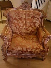 brown wooden frame brown floral padded armchair Palmdale, 93551
