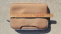 beige and gray laptop sleeve