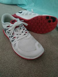 pair of white-and-red Nike low-top sneakers