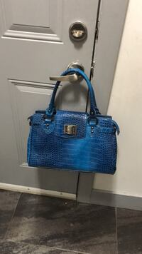blue and brown leather tote bag Edmonton, T6N 1M1