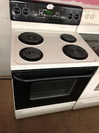 GE black and beige electric coil range stove  47 km