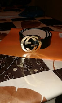 black leather belt with silver Gucci belt buckle