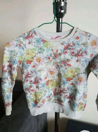 white, pink, and green floral long sleeve shirt