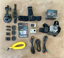 GOPRO HERO W/ MULTIPLE ATTACHMENTS AND SD CARD