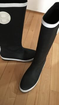 pair of black and white rain boots Silver Spring, 20902