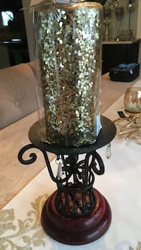 Wrought iron candle pillar with large gold glitter candle