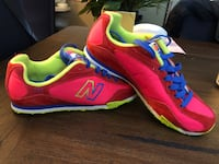 Pair of pink and red New Balance running shoes