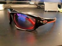 Red and black Oakley sunglasses
